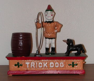 trick dog cast iron bank